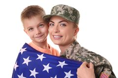 Woman soldier and little kid with American national flag. On white background royalty free stock photo