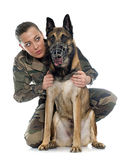 Woman soldier and malinois. In front of white background Stock Photography