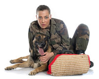 Woman soldier and malinois. In front of white background Stock Images