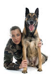 Woman soldier and malinois. In front of white background Royalty Free Stock Photo
