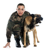 Woman soldier and malinois Royalty Free Stock Images