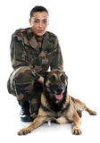 Woman soldier and malinois. In front of white background Stock Photos