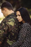 Woman and soldier in a military uniform. Say goodbye before a separation stock images