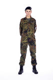 Woman soldier stands in attitude. Pretty woman soldier stands in attitude stock image
