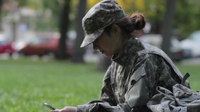 Woman Soldier using the phone stock video footage