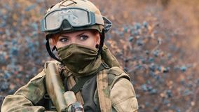 A woman soldier with a weapon. HD video stock video footage