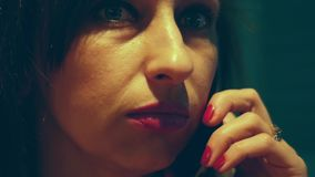 A woman solves problems by talking on the phone. Close-up stock footage
