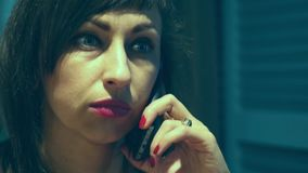 A woman solves problems by talking on the phone. Close-up stock video footage
