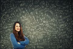 Woman solving equations stock photography