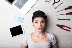 Computer no problem says this woman. Woman solving every IT hardware and software problem with her black hat and positive attitude Royalty Free Stock Photography