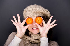Woman with some fruit's. On her eyes stock photography