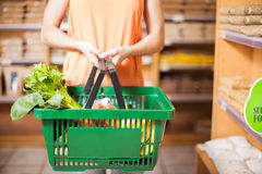 Woman with some groceries in a basket royalty free stock photography