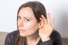 Woman with some hearing problems Stock Photo