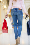 Woman with some shopping bags in the mall Royalty Free Stock Photography