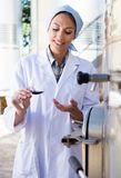 Sommelier is tasting wine at Italian wine factory. Woman sommelier is tasting wine at Italian wine factory stock images
