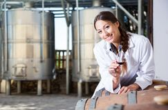 Woman sommelier is tasting wine at wine factory. Woman sommelier is tasting wine at Italian wine factory stock images