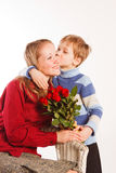 Woman with a son and with the bouquet of red roses Royalty Free Stock Photo