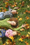 Woman with son and daughter. Woman with the son and the daughter they lie on the grass Royalty Free Stock Photography