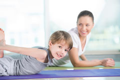 Woman with son doing morning stretching. Healthy morning stretching - women with son doing gymnastic exercise at home Stock Images