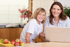 Woman with son on the laptop Royalty Free Stock Photos