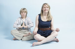 Woman and son meditating Stock Photos