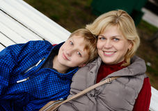 Woman and son. Middle age women and son outdoors Royalty Free Stock Images