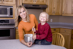 Woman and son mixing Royalty Free Stock Photo
