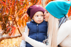 Woman with son in peach garden Stock Image