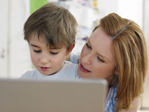 Woman And Son Using Laptop At Home Royalty Free Stock Image