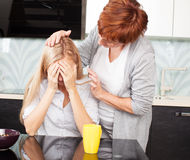 Woman soothes sad female Stock Photography