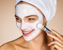 Woman with soothing facial mask. Stock Images