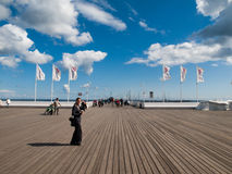 Woman on Sopot pier. SOPOT, POLAND - CIRCA 2014: The Sopot Pier is the longest wooden pier in Europe, 511 m. Taken on sunny end of summer day circa 2014 in Sopot Royalty Free Stock Image