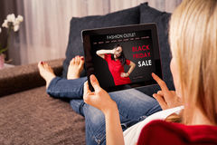 Woman Sopping on Black Monday. On tablet royalty free stock photography