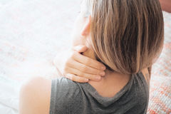 Woman with sore neck, neck pain royalty free stock photo