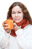 Woman with a sore throat drinking hot tea from a cup Stock Photos