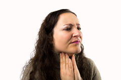 Woman with a sore throat. Portrait of a woman with a sore throat with white background stock photo