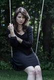 Woman in sorrow. Sitting on the swing Royalty Free Stock Photography