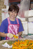Woman sorting chillies Stock Photography