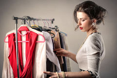 Woman sorting through clothes stock photos