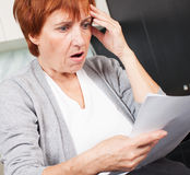 Woman sorting through her old receipts Royalty Free Stock Photography