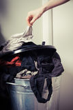 Woman sorting out her laundry. Young woman is sorting out her laundry at home Stock Photography