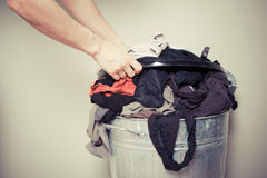 Woman sorting out her laundry. Young woman is sorting out her laundry at home Royalty Free Stock Photos