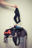 Woman sorting out her laundry. Young woman is sorting out her laundry at home Royalty Free Stock Photo