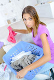 Woman sorting out laundry Stock Image