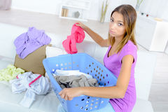 Woman sorting out laundry Royalty Free Stock Photo