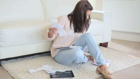Woman sorting receipts