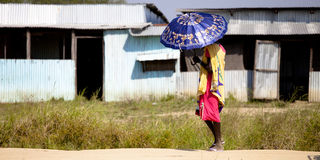 Woman in South Sudan with umbrella from sun Royalty Free Stock Photo