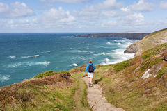 Woman on South West Coast Path in Cornwall Royalty Free Stock Photos