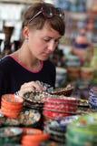 Woman in souvenir shop Royalty Free Stock Photo