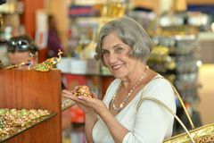 Woman at souvenir store Royalty Free Stock Photo